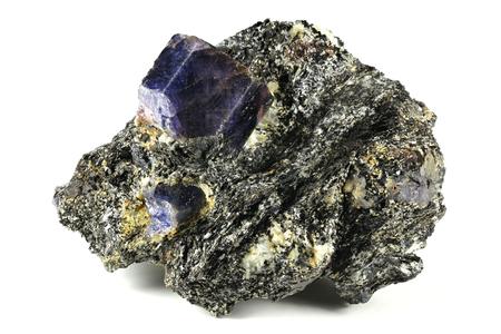 Sapphire nestled in bedrock found in Zazafotsy Quarry, Fianarantsoa Madagascar Reklamní fotografie