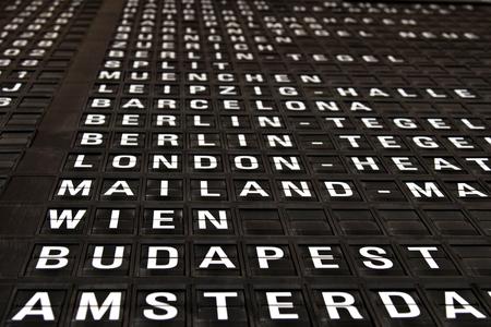 destination board at airport Stock Photo