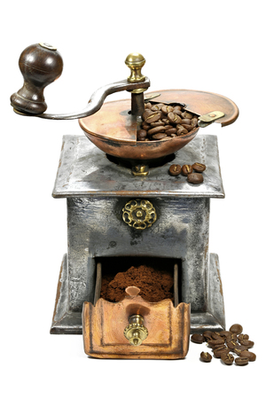 vintage coffee grinder with manufacture roasted Indonesian Arabica coffee beans isolated on white background