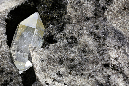 Herkimer diamond nestled in bedrock