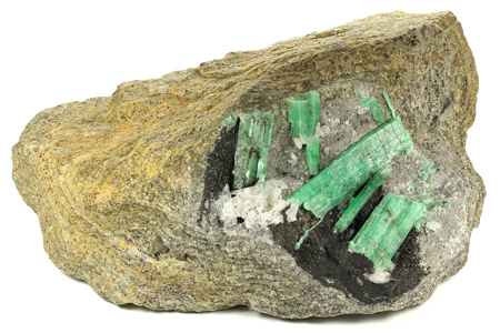 emeralds nestled in bedrock found in Hunan China isolated on white background