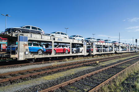 autorack with new Skoda cars for export to Scandinavia at BLG Logistics seaport terminal in Cuxhaven, Germany