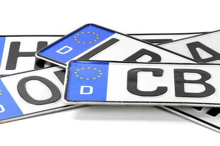group of German license plates isolated on white background Фото со стока