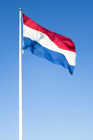 Dutch flag flying in the wind Archivio Fotografico
