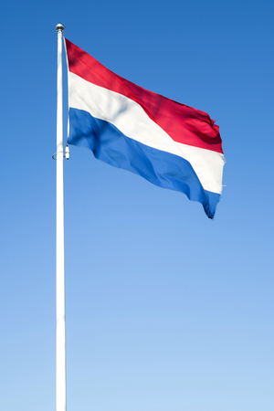 Dutch flag flying in the wind Banque d'images