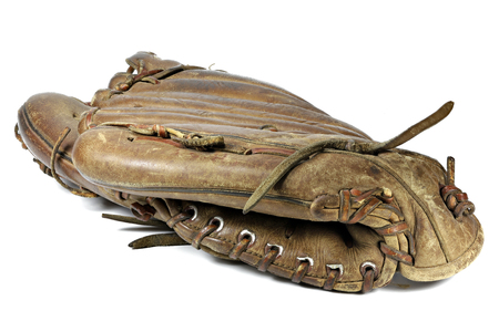 worn baseball glove isolated on white background 写真素材
