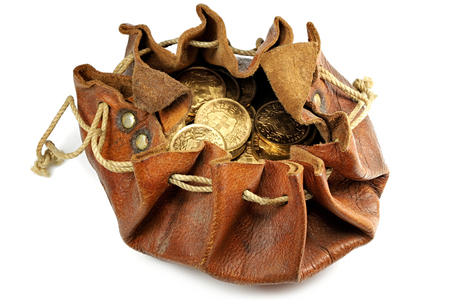 Swiss Vreneli gold coins in a leather purse isolated on background Foto de archivo
