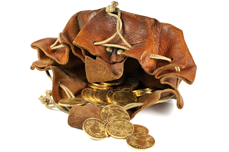 Swiss Vreneli gold coins in a leather purse isolated on background 스톡 콘텐츠