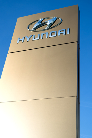 Hyundai dealership sign against blue sky. Hyundai is the largest vehicle manufacturer in South Korea. 報道画像