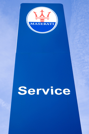 Maserati dealership sign against blue sky. Maserati is an Italian luxury vehicle manufacturer established on 1 December 1914, in Bologna.