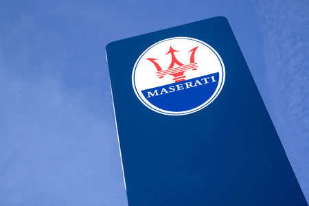 Maserati dealership sign against blue sky. Maserati is an Italian luxury vehicle manufacturer established on 1 December 1914, in Bologna. 版權商用圖片 - 107048020