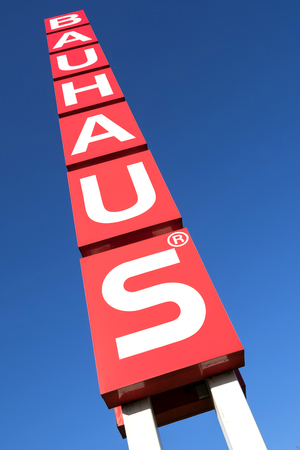 Bauhaus sign against blue sky. Bauhaus is a Swiss-headquartered pan-European retail chain offering products for home improvement, gardening and workshop. Redactioneel