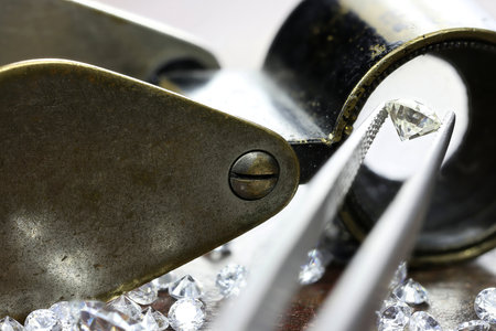 brilliant cut diamond held by tweezers Standard-Bild