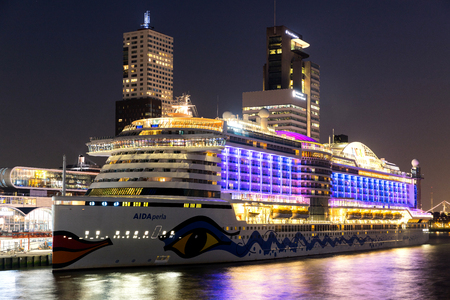 AIDAperla at Cruise Terminal Rotterdam. AIDAperla is the newest and most modern cruise ship of AIDA Cruises, one of ten brands owned by Carnival Corp.