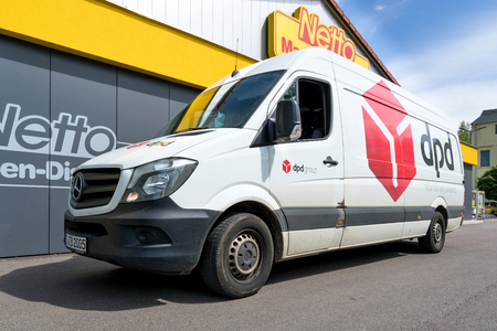 dpd delivery van at Netto discount store. DPDgroup is the international parcel delivery network of French state owned postal service, La Poste.