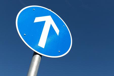 German road sign: go straight ahead Фото со стока