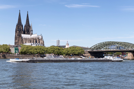 inland tanker vessel JUDITH of MTS passing Cologne Cathedral