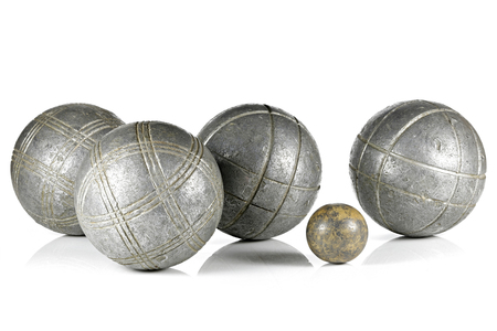 vintage petanque balls isolated on white background Фото со стока