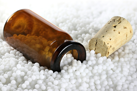 brown bottle within homeopathic pills
