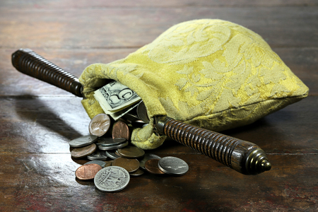 collection bag filled with US Coins on rustic wooden background 스톡 콘텐츠