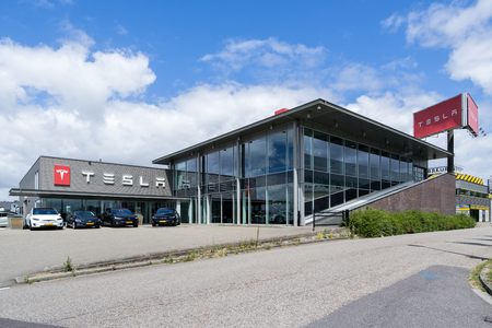 Tesla store in Rotterdam, Netherlands. Tesla is an American multinational corporation that specializes in electric vehicles, energy storage and solar panel manufacturing.