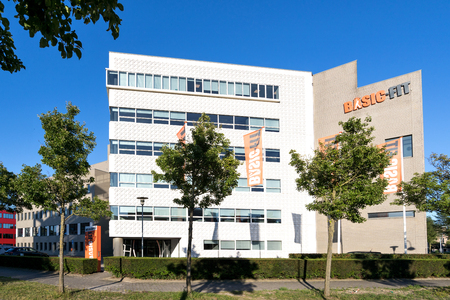 Basic-Fit headquarters in Hoofddorp, Netherlands. With 1.65 million members and over 530 clubs, Basic-Fit is the European market leader in the value-for-money fitness market. Redakční