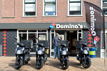 Domino's restaurant. Domino's is an American pizza restaurant chain founded in 1960.