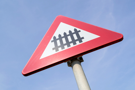 Dutch road sign: level crossing with barrier or gates ahead