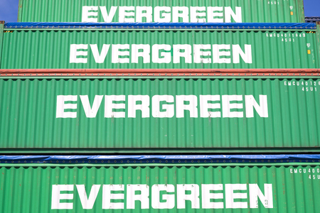 Evergreen 40 ft intermodal containers stacked in harbor. Evergreen headquartered in Taiwan is a global containerized-freight shipping company.