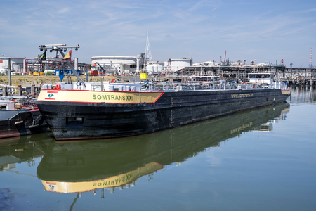 Tankbarge SOMTRANS XXII in the port of Rotterdam. Somtrans is a Belgian tanker shipping company with fully-owned barges. Redactioneel