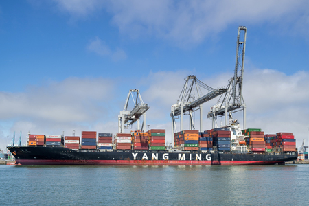 Container ship YM EVOLUTION. Yang Ming Marine Transport Corporation is an ocean shipping company based in Keelung, Taiwan.