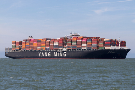Container ship YM WELLHEAD inbound Rotterdam. Yang Ming Marine Transport Corporation is an ocean shipping company based in Keelung, Taiwan. Editorial