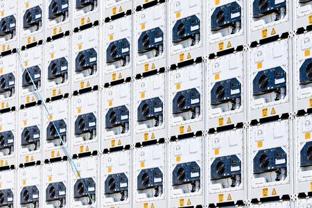 refrigerated containers stacked in harbor Banco de Imagens