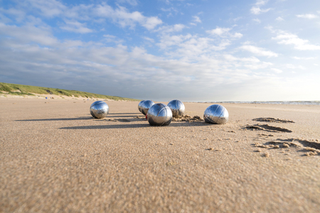 petanque balls on sandy beach