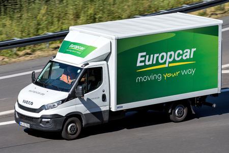 Iveco Daily of Europcar on motorway. Europcar Mobility Group is a French car rental company founded in 1949 in Paris. Standard-Bild - 111378900