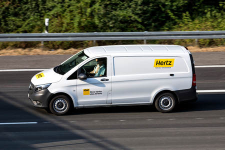Mercedes-Benz Vito of Hertz on motorway. The Hertz Corporation is an American car rental company based in Estero, Florida. Standard-Bild - 107049259