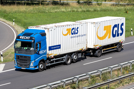 GLS truck on motorway. General Logistics Systems B.V. was founded in 1999 and is a subsidiary of British postal service Royal Mail.