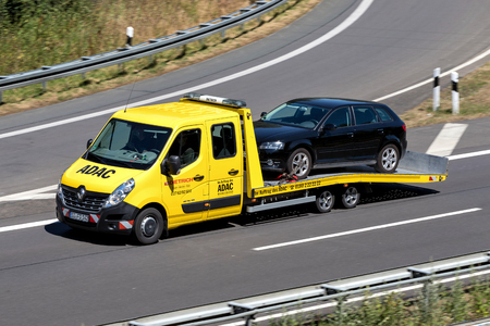 ADAC flatbed recovery vehicle on motorway. German ADAC it is the largest automobile club in Europe.