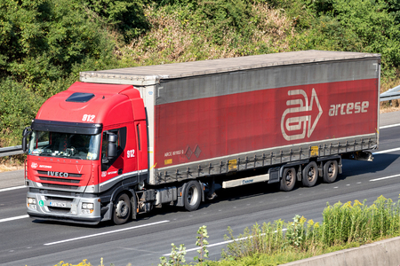 Arcese truck on motorway. Arcese is one of Europe's major private logistics operators with over 2,500 staff members and 350,000 m² of warehouses.