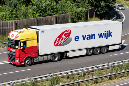 E. van Wijk truck on motorway. E. van Wijk is a Dutch logistics company, founded by Ewout van Wijk in 1949, with its headquarters in Giessen. Stockfoto - 107049385