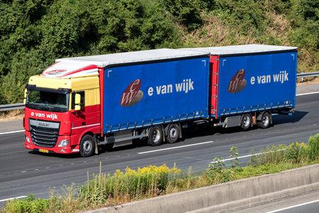 E. van Wijk truck on motorway. E. van Wijk is a Dutch logistics company, founded by Ewout van Wijk in 1949, with its headquarters in Giessen. Stockfoto - 107049386