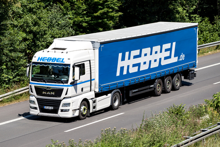 Hebbel truck on motorway. Hebbel is a German travel and logistics company based in Leverkusen with many years of experience in steel logistics.