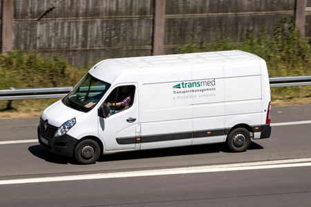 Transmed van on motorway. Transmed was foundet in 1970 and operates more than 3,000 vehicles, including 350 PharmaMobiles. Standard-Bild - 107049415