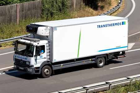 Transthermos truck on motorway. Transthermos dispatches 700 refrigerated trucks and transports 3.6 million pallets with a total weight of 1.3 million tons per year. Redakční