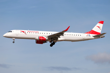 Austrian Airlines Embraer ERJ-195 with registration OE-LWP on short final for runway 25L of Frankfurt Airport.