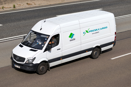 Simile van on motorway. Simile UAB offers express cargo door-to-door delivery, transportation and logistics services within Europe using vehicles up to 3.5 tons.