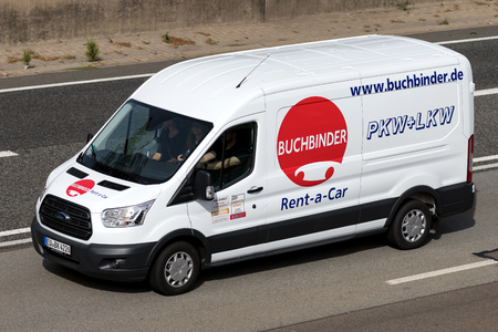 Ford Transit of Buchbinder on motorway. Buchbinder is a German car rental company and part of the French Europcar Mobility Group. Standard-Bild - 111379842
