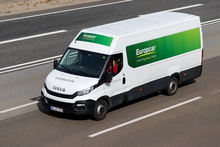 Iveco Daily of Europcar on motorway. Europcar Mobility Group is a French car rental company founded in 1949 in Paris.