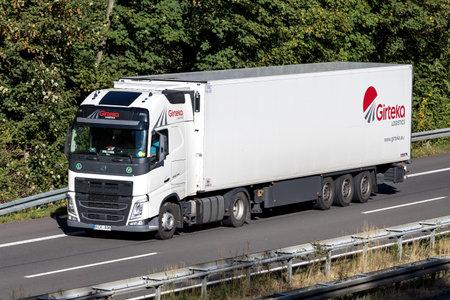 Girteka truck on motorway. Girteka Logistics is Europe's leading asset based Transport Company, delivering more than 420.000 Full truck loads annually.