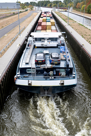 inland container vessel MILANO in the Main River lock of Eddersheim sluice west of Frankfurt, Germany
